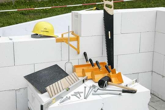 Как выбрать клей для строительства дома из блоков?